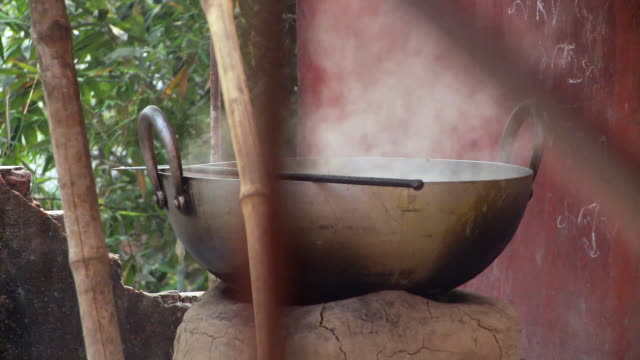 Closeup view of large steaming pot