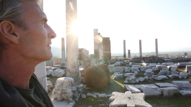 close-up view of man exploring monument ruins, sunrise - izmir stock videos & royalty-free footage