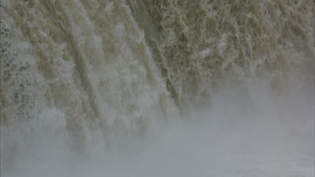 close-up view of the front slope of a powerful plunging waterfall. - falling water stock videos & royalty-free footage