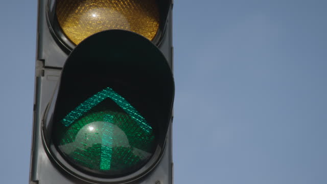 close-up view of traffic reflected in the round surface of traffic lights, india. - indian arrowhead stock videos and b-roll footage