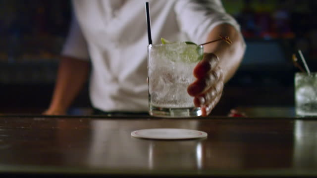 close-up: vodka drink being served at bar (shot on red) - alkoholisches getränk stock-videos und b-roll-filmmaterial
