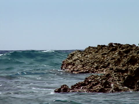 closeup waves crashing on rock in north atlantic ocean/ guantanamo bay guantanamo province cuba - north atlantic ocean stock videos & royalty-free footage
