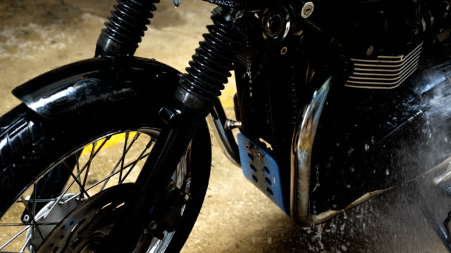 close-up wet part of classic motorcycle. - wet wet wet stock videos & royalty-free footage