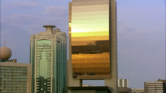 Close-up - wide shot Sunlight reflecting on Dubai Creek from National Bank of Dubai Building/ Dubai, United Arab Emirates