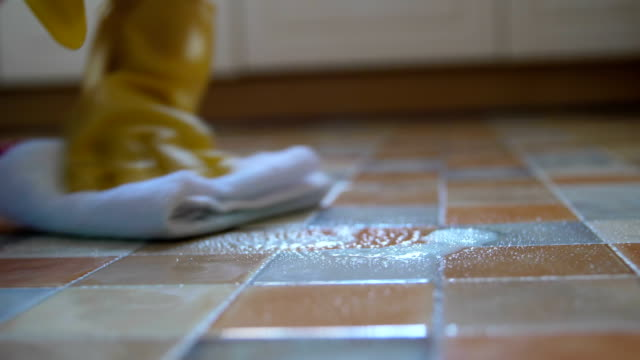 close-up woman cleaning tiled - piastrella video stock e b–roll