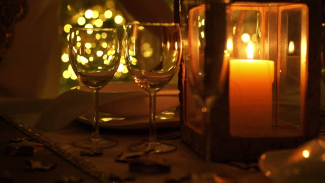 closeup woman decorating dinner table for christmas - candlelight stock videos and b-roll footage