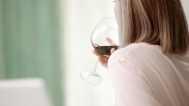 Close-up, woman drinking red wine