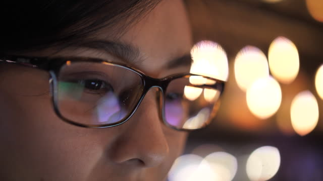 close-up woman eye looking on computer monitor screen, reflection on eyeglasses - freelance work stock videos & royalty-free footage