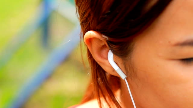 Close-up Woman hand and headphones