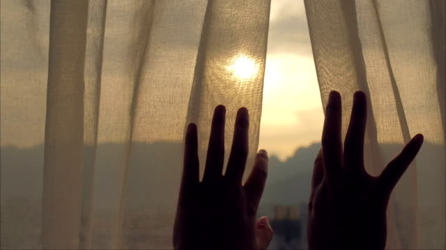 close-up woman hand open curtain - sunrise dawn stock videos & royalty-free footage