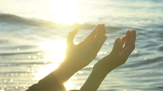 closeup woman hands praying for blessing from god during sunset background - praying stock videos & royalty-free footage