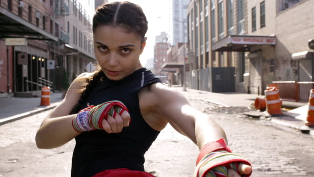 close-up woman kickboxing in street/ manhattan, new york, usa - kickboxing stock videos and b-roll footage