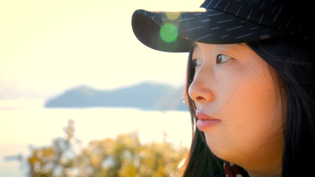 Close-up woman looking natural scenery