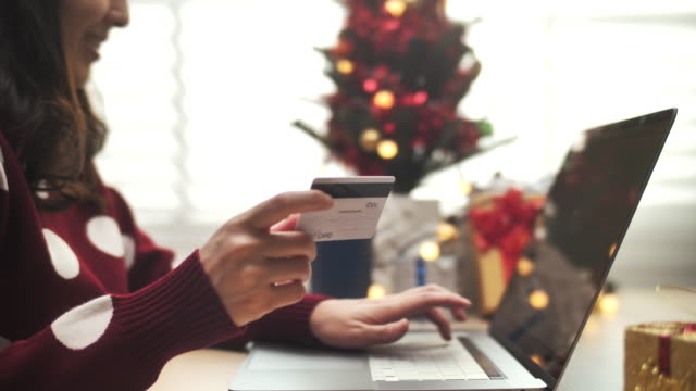 close-up woman online shopping in christmas event - shopaholic stock videos & royalty-free footage