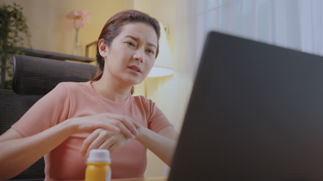 close-up woman online therapy with doctor via laptop video call and stretching from advice at home. - health technology stock videos & royalty-free footage