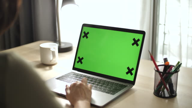 close-up woman using chroma key screen laptop computer on desk at home - only women stock videos & royalty-free footage