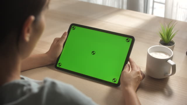 close-up woman using digital tablet green screen on desk at home - digital tablet stock videos & royalty-free footage