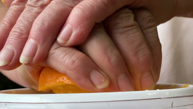 close-up, woman using electric citrus juicer to squeeze an orange, westerville, ohio - electric juicer stock videos & royalty-free footage