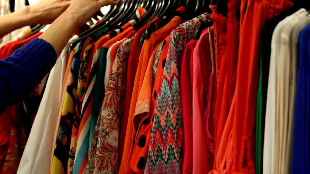 closeup woman's hands looking through clothes - wardrobe stock videos & royalty-free footage