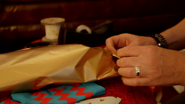 close-up wrapping christmas presents - cosy stock videos & royalty-free footage