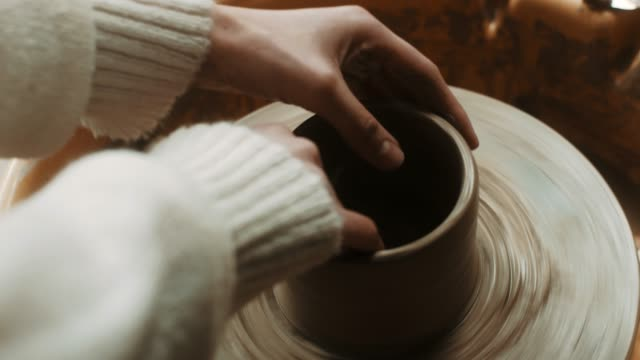 close-up, young beautiful woman using pottery wheel at atelier - pottery stock videos & royalty-free footage