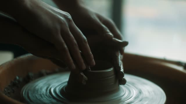 close-up, young beautiful woman using pottery wheel at atelier - sculpture stock videos & royalty-free footage