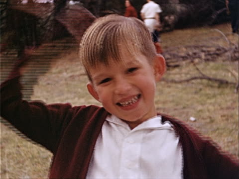 1940 close-up young boy scratching head and smiling in griffith park / los angeles, california, usa  - 1940 stock videos & royalty-free footage