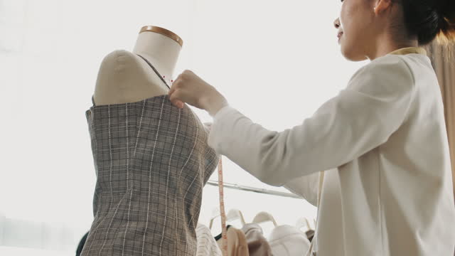 close-up young designer measuring on her design clothing in fashion design - designer clothing stock videos & royalty-free footage