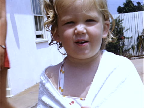 1952 close-up young girl standing poolside wrapped in beach towel / beverly hills, california, usa  - 1952 stock videos & royalty-free footage