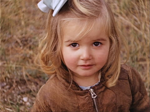 1940 close-up young girl wearing jacket and hair bow in griffith park / los angeles, california, usa  - one girl only stock videos & royalty-free footage