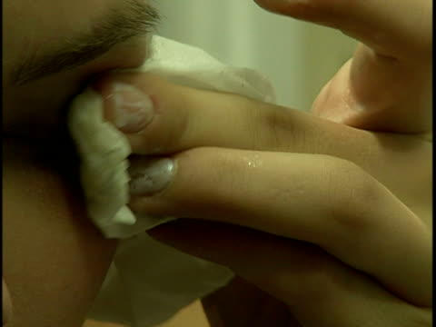 close-up young woman removing eye make-up with tissue - rubbing stock videos and b-roll footage