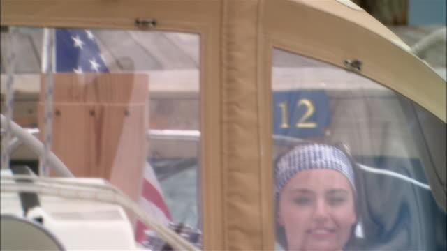 vídeos de stock e filmes b-roll de close-up young woman sitting in boat and looking through window/ harbor island, bahamas - olhar de lado