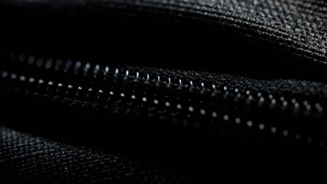 close-up zipper being zipped closed and open - borsetta video stock e b–roll