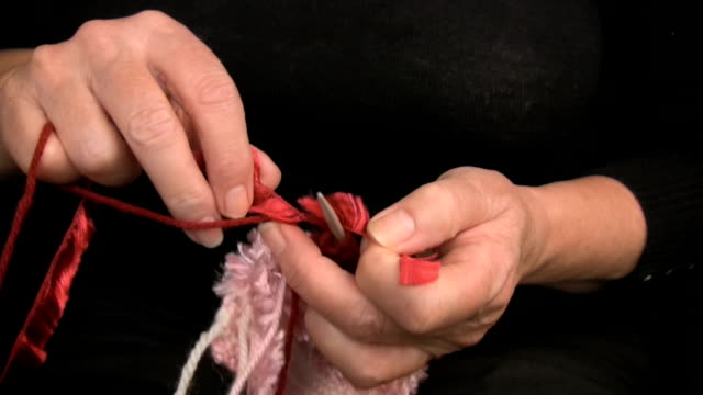 close-upclose-up of woman's hands knotting new wool in knitting - knitting needle stock videos & royalty-free footage