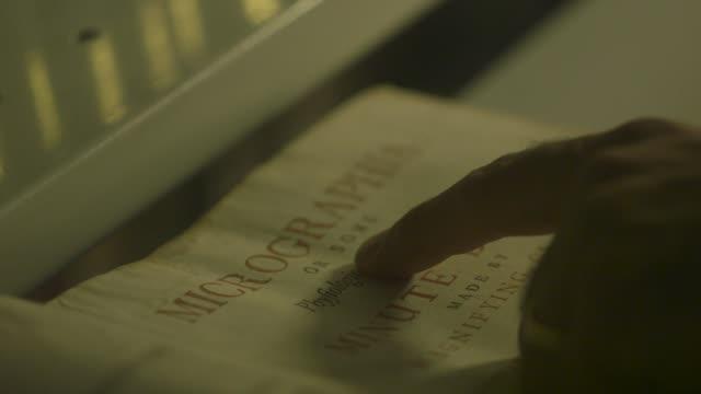 close-ups of robert hooke's 'micrographia' - e book stock videos & royalty-free footage