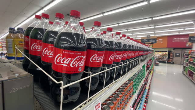 close-ups of shelves full of coca-cola drinks in harmon grocery store in orem. coca cola is scheduled to announce their fourth-quarter 2020 earnings... - orem stock videos & royalty-free footage