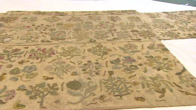 closeups on fabric which once formed part of a dress worn by queen elizabeth i - elizabeth i of england stock videos & royalty-free footage