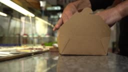Closing a paper box for food delivery