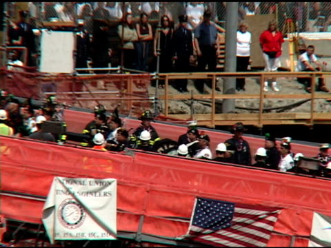 closing ceremony at ground zero, may 30, 2002- bagpipe & drum band continue up ramp to drumbeat . spectators in bg. then, workers stand at attention... - bagpipes stock videos & royalty-free footage