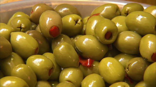 closing up on green olives - bowl stock videos and b-roll footage