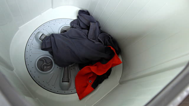 clothes and water in a washing machine - top garment stock videos & royalty-free footage