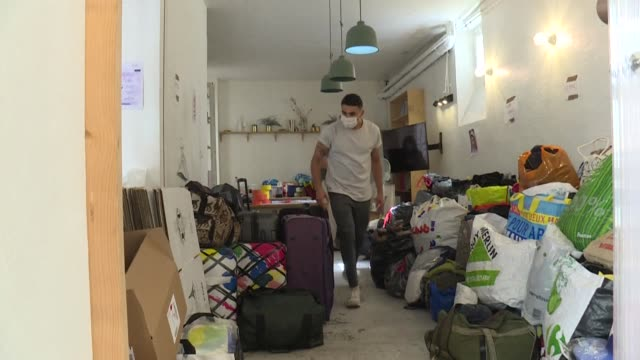 clothes, baby food, hygiene products: in paris, young franco-lebanese volunteers collect donations and prepare suitcases to help the inhabitants of... - collection stock videos & royalty-free footage