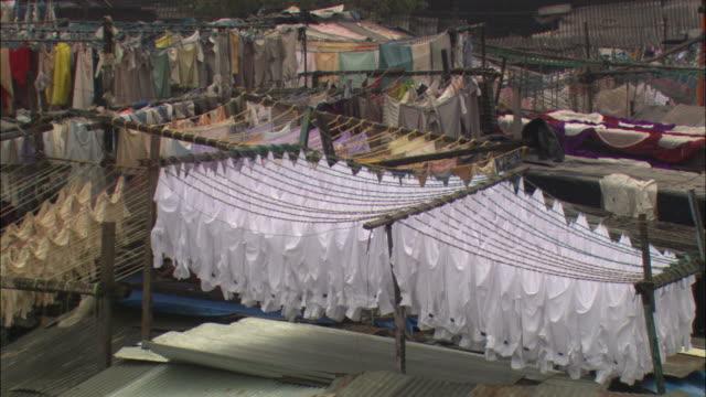 ha, pan, ms, clothes drying on rooftop next to public outdoor laundry, mumbai, maharashtra, india - mumbai stock videos & royalty-free footage