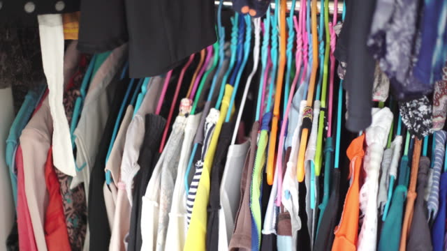clothes hanging in wardrobe at home - wardrobe stock videos & royalty-free footage