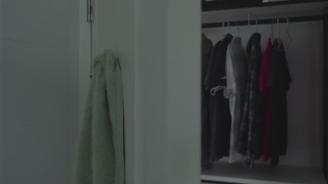 clothes hanging in wardrobe - open house stock videos & royalty-free footage