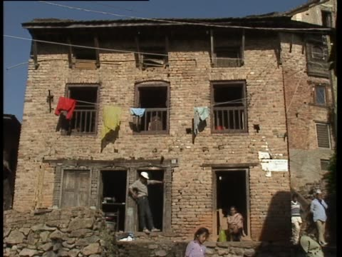 clothes hanging on makeshift washing line on side of building nepal - makeshift stock videos & royalty-free footage