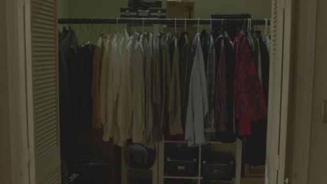 MS Clothes hanging on rack inside closet / Toronto, Ontario, Canada