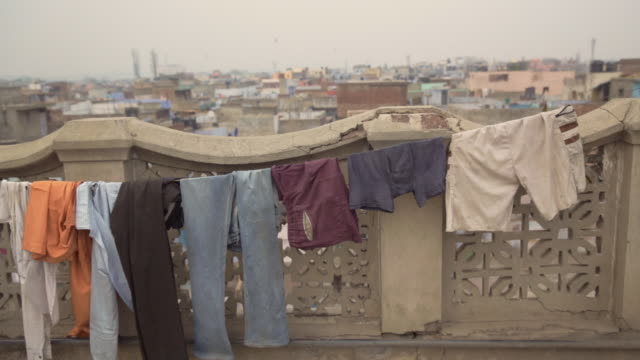 clothes hanging on the rooftop, india - washing line stock videos & royalty-free footage