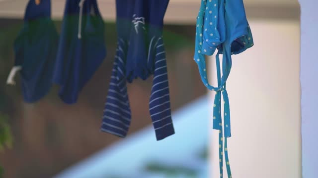 clothes hanging outdoors - one piece swimsuit stock videos & royalty-free footage