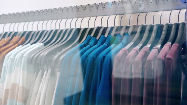 clothes hanging rail in clothes shop - textile stock videos & royalty-free footage